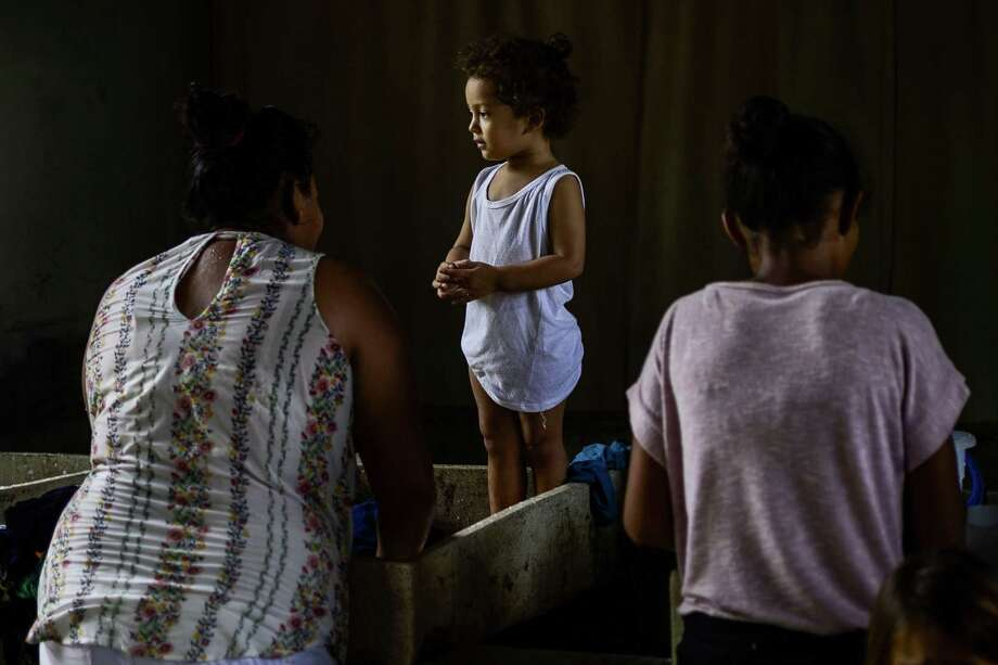 TOPSHOT - Migrants in the hopes of reaching the United States wash clothes by hand at a shelter in Tapachula, Chiapas state, Mexico, on June 8, 2019. - The United States and Mexico reached an 11th-hour deal late Friday to crack down on migration from Central America, with President Donald Trump relenting on threats to slap potentially devastating tariffs on Mexican goods. The crackdown has made reaching the United States an increasingly impossible dream for migrants as Mexico has increased migrant detentions, restricted visas, stepped up military and police patrols and agreed to deploy 6,000 members of its new National Guard to reinforce the border area. (Photo by PEDRO PARDO / AFP)PEDRO PARDO/AFP/Getty Images Photo: PEDRO PARDO, Contributor / AFP/Getty Images / AFP or licensors