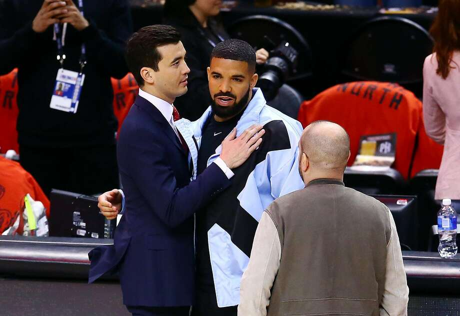 General Manager Bobby Webster of the Toronto Raptors greets Drake prior to Game Five of the 2019 NBA Finals between the Golden State Warriors and the Toronto Raptors at Scotiabank Arena on June 10, 2019 in Toronto, Canada. Photo: Vaughn Ridley, Getty Images