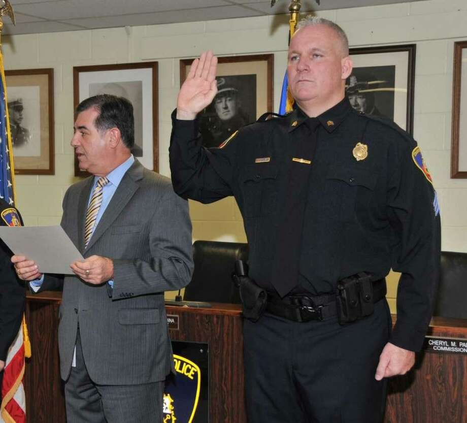 Christopher Broems is sworn in as a sergeant by then Mayor Michael Pavia at the Stamford Police Department in 2012. Photo: Contributed Photo