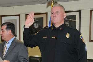 Christopher Broems is sworn in as a sergeant by then Mayor Michael Pavia at the Stamford Police Department in 2012.