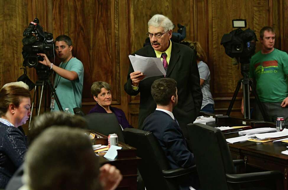 Albany County Legislator Doug Bullock reads the reasons he's going to vote for the paid sick days legislation ahead of a vote during an Albany County Legislature meeting at the Albany County Courthouse on Monday, June 10, 2019 in Albany, N.Y. The legislature voted down the paid sick leave measure 21-17. (Lori Van Buren/Times Union)