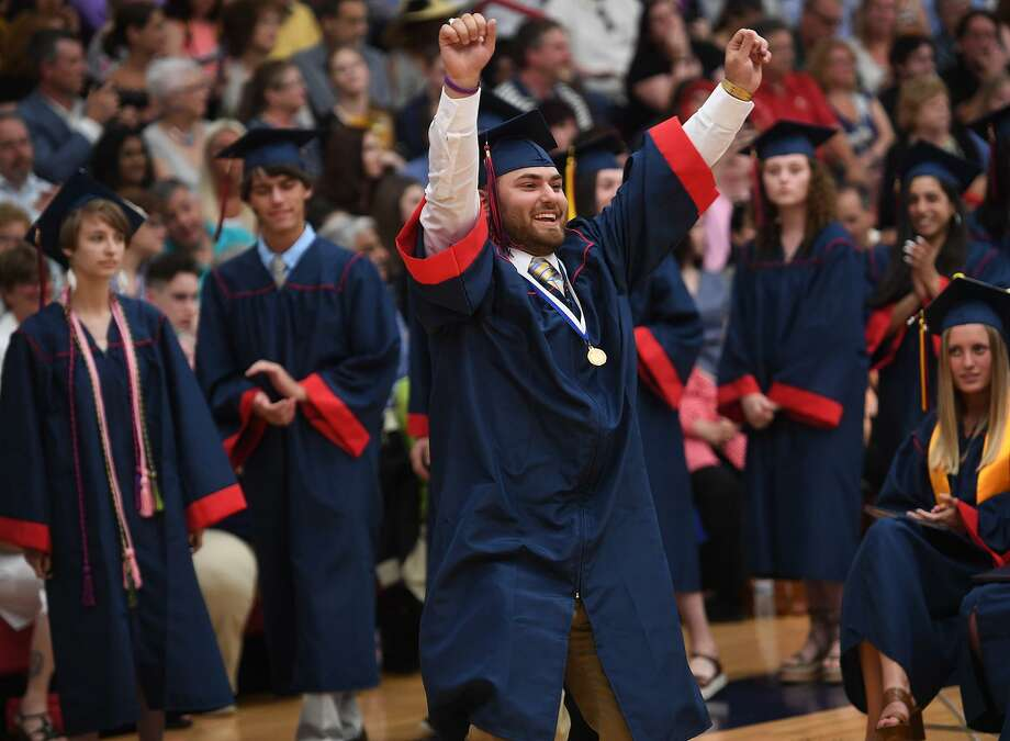 Graduate Joseph Mendillo raises his arms in celebration as he walks up to receive his diploma at the Foran High School Graduation in Milford, Conn. on Monday, June 10, 2019. Photo: Brian A. Pounds / Hearst Connecticut Media / Connecticut Post
