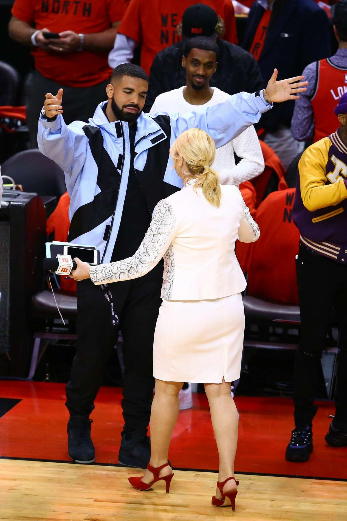 Rapper Drake speaks to TV personality Doris Burke before Game Five between the Toronto Raptors and the Golden State Warriors of the 2019 NBA Finals at Scotiabank Arena on June 10, 2019 in Toronto, Canada.