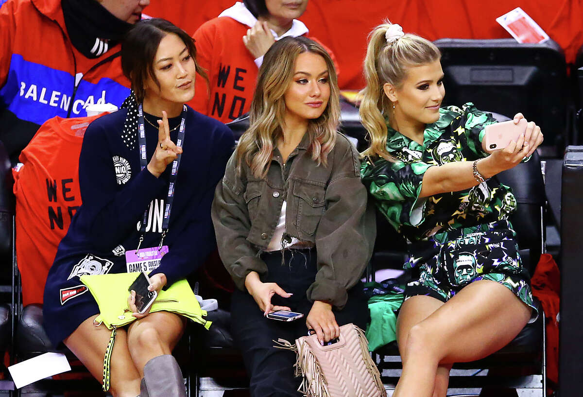 Golfer Michelle Wie, Celeste Bouchard and tennis player Eugenie Bouchard attend Game Five of the 2019 NBA Finals between the Golden State Warriors and the Toronto Raptors at Scotiabank Arena on June 10, 2019 in Toronto, Canada.