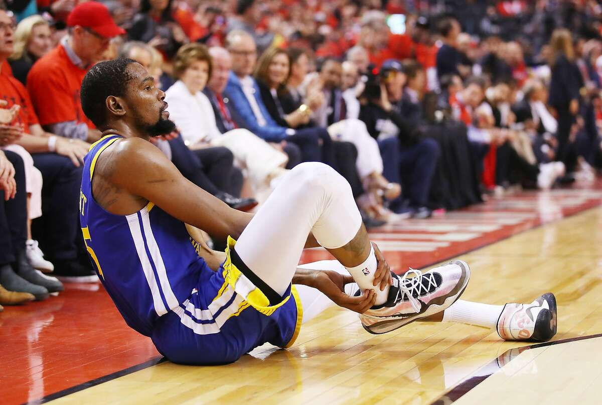 Kevin Durant #35 of the Golden State Warriors reacts after sustaining an injury during the second quarter against the Toronto Raptors during Game Five of the 2019 NBA Finals at Scotiabank Arena on June 10, 2019 in Toronto, Canada.
