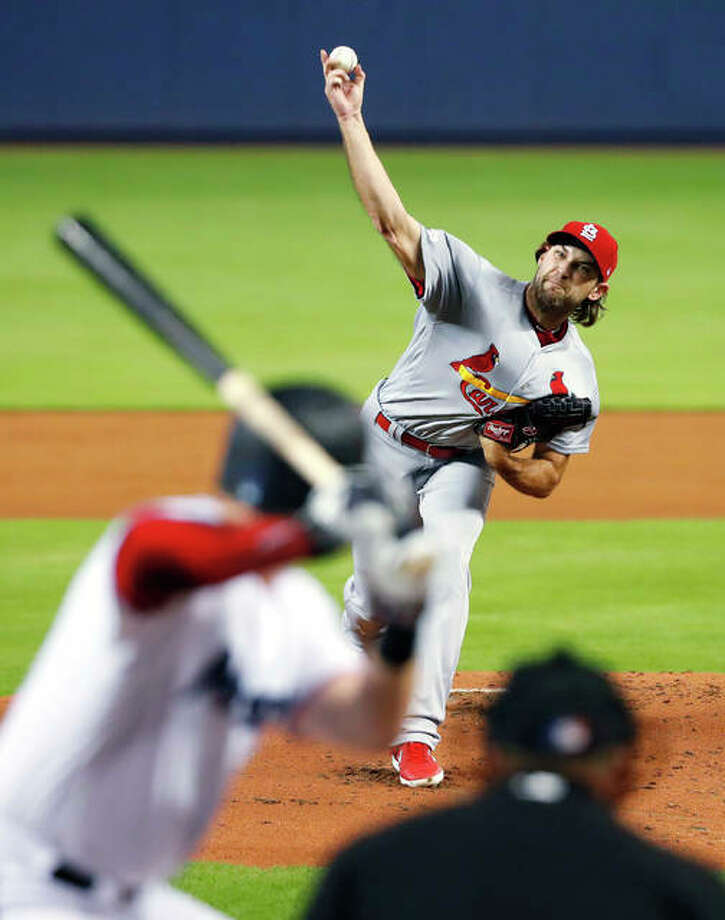 The Cardinals' Michael Wacha pitches to the Marlins' Garrett Cooper during Monday night's game in Miami. Photo: AP Photo