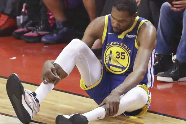 9b09458f 1of3Golden State Warriors' Kevin Durant checks his right leg in the second  quarter during game 5 of the NBA Finals between the Golden State Warriors  and the ...
