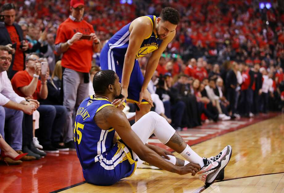 Kevin Durant #35 of the Golden State Warriors reacts after sustaining an injury during the second quarter against the Toronto Raptors during Game Five of the 2019 NBA Finals at Scotiabank Arena on June 10, 2019 in Toronto, Canada.  Photo: Gregory Shamus, Getty Images