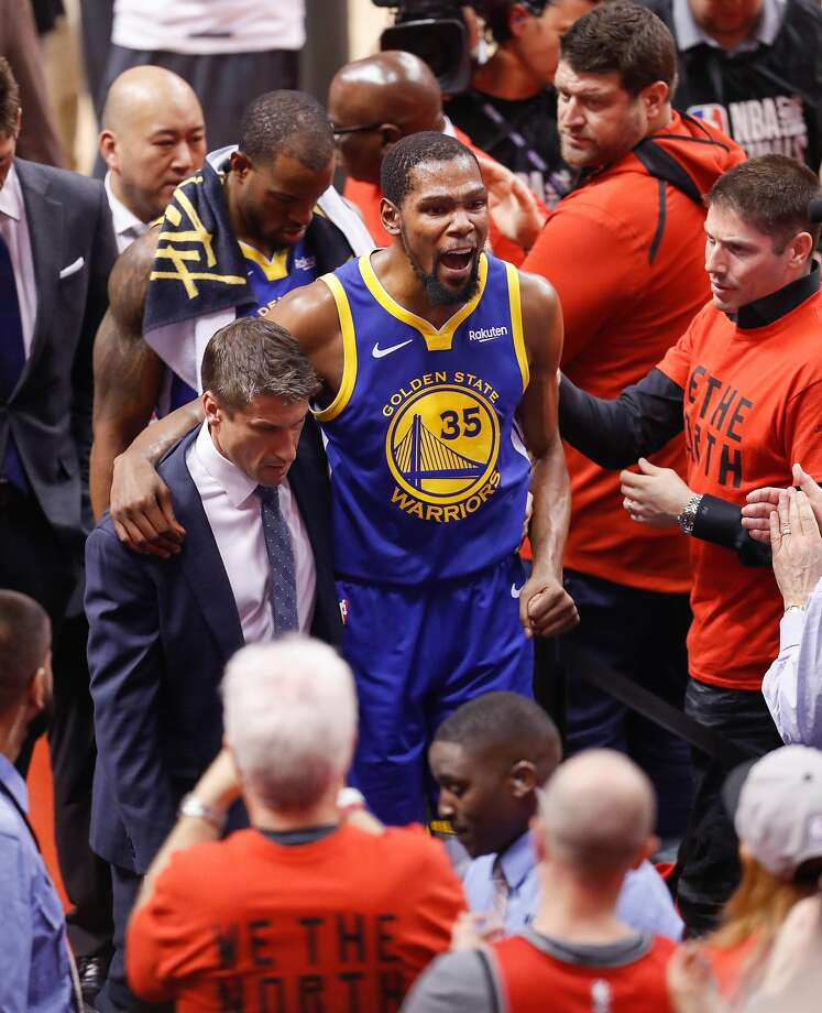 Golden State Warriors' Kevin Durant leaves the game in the second quarter during game 5 of the NBA Finals between the Golden State Warriors and the Toronto Raptors at Scotiabank Arena on Monday, June 10, 2019 in Toronto, Ontario, Canada. Photo: Scott Strazzante, The Chronicle