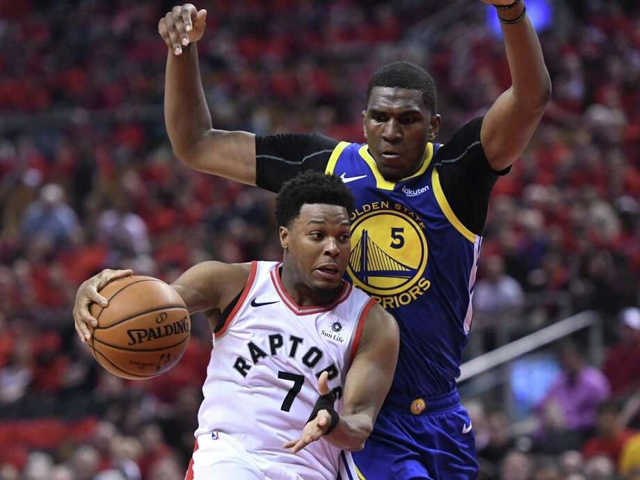 Toronto Raptors guard Kyle Lowry (7) handles the ball under pressure from Golden State Warriors center Kevon Looney (5) during second-half basketball action in Game 5 of the NBA Finals in Toronto, Monday, June 10, 2019.  Photo: Frank Gunn / Associated Press / The Canadian Press