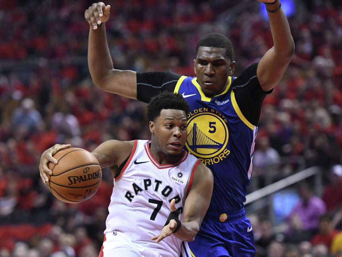 Toronto Raptors guard Kyle Lowry (7) handles the ball under pressure from Golden State Warriors center Kevon Looney (5) during second-half basketball action in Game 5 of the NBA Finals in Toronto, Monday, June 10, 2019.