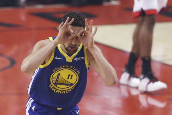 Golden State Warriors' Klay Thompson reacts after scoring in the first quarter during game 5 of the NBA Finals between the Golden State Warriors and the Toronto Raptors at Scotiabank Arena on Monday, June 10, 2019 in Toronto, Ontario, Canada.