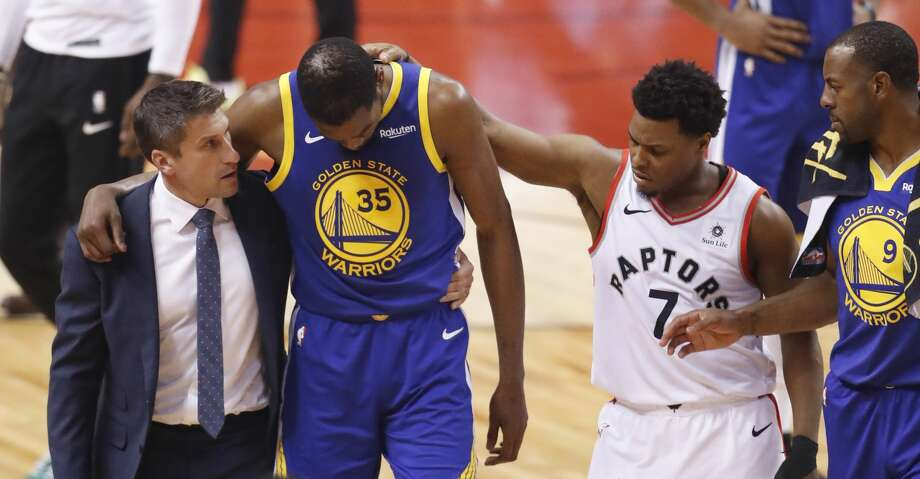 Toronto Raptors' Kyle Lowry reaches out to Golden State Warriors' Kevin Durant as he's helped off the court in the second quarter during game 5 of the NBA Finals between the Golden State Warriors and the Toronto Raptors at Scotiabank Arena on Monday, June 10, 2019 in Toronto, Ontario, Canada. Photo: Scott Strazzante/The Chronicle