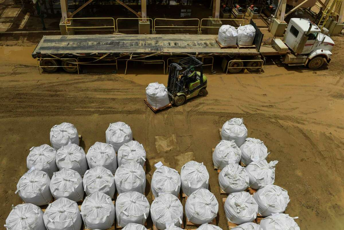 Slings oif rare earths concentrate ready for shipment are placed on a flatbed truck at the Mountain Pass Mine.