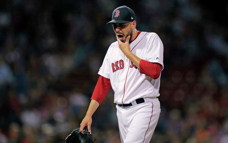 Boston Red Sox relief pitcher Matt Barnes walks to the dugout after being pulled, after giving up a two RBI singles to Texas Rangers' Nomar Maraza in the ninth inning of a baseball game at Fenway Park in Boston, Monday, June 10, 2019. (AP Photo/Charles Krupa) Photo: Charles Krupa / Copyright 2019 The Associated Press. All rights reserved