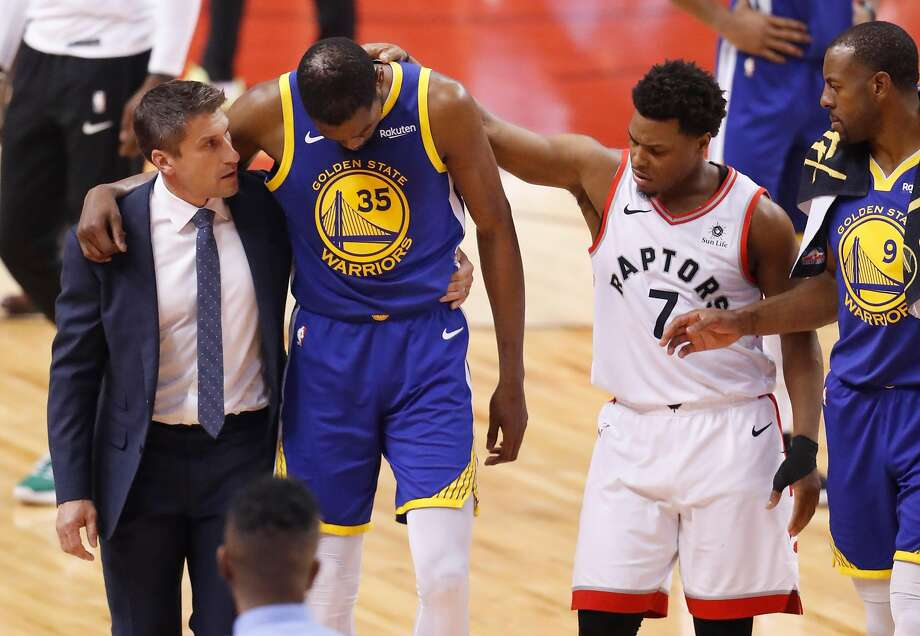 Toronto Raptors' Kyle Lowry reaches out to Golden State Warriors' Kevin Durant as he's helped off the court in the second quarter during game 5 of the NBA Finals between the Golden State Warriors and the Toronto Raptors at Scotiabank Arena on Monday, June 10, 2019 in Toronto, Ontario, Canada. Photo: Scott Strazzante / The Chronicle