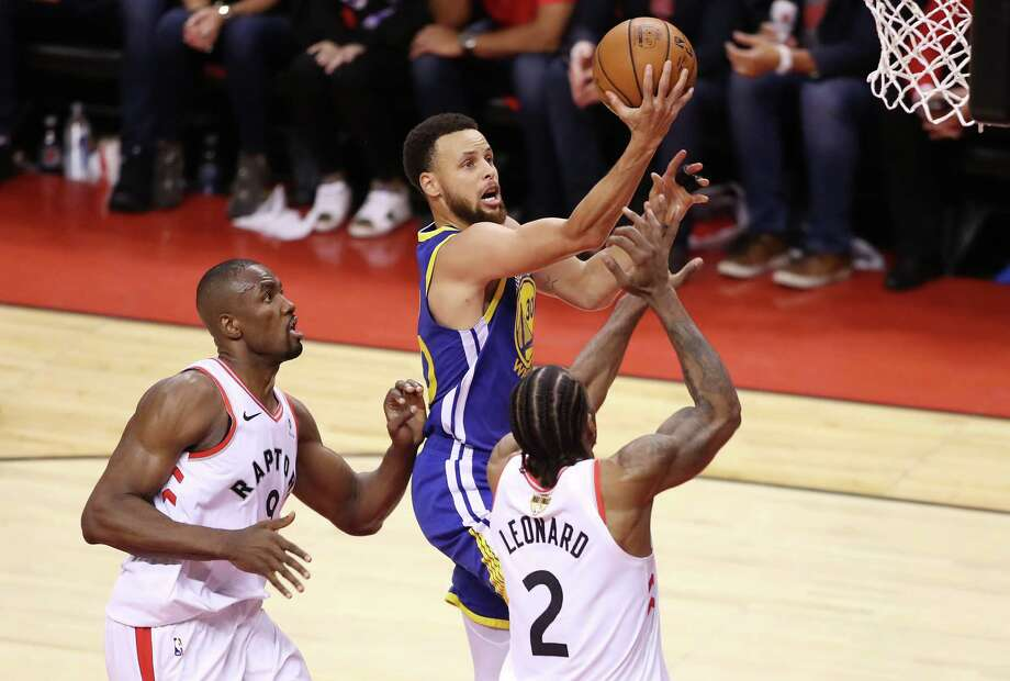 TORONTO, ONTARIO - JUNE 10:  Stephen Curry #30 of the Golden State Warriors attempts a shot against Serge Ibaka #9 and Kawhi Leonard #2 of the Toronto Raptors in the second half during Game Five of the 2019 NBA Finals at Scotiabank Arena on June 10, 2019 in Toronto, Canada. NOTE TO USER: User expressly acknowledges and agrees that, by downloading and or using this photograph, User is consenting to the terms and conditions of the Getty Images License Agreement. (Photo by Claus Andersen/Getty Images) Photo: Claus Andersen / 2019 Getty Images