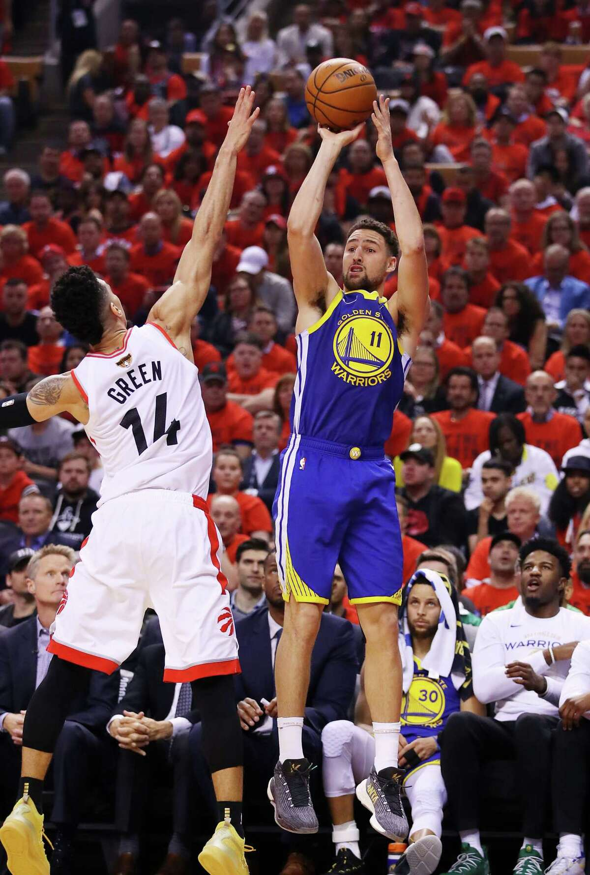 TORONTO, ONTARIO - JUNE 10: Klay Thompson #11 of the Golden State Warriors attempts a shot against Danny Green #14 of the Toronto Raptors in the first half during Game Five of the 2019 NBA Finals at Scotiabank Arena on June 10, 2019 in Toronto, Canada. NOTE TO USER: User expressly acknowledges and agrees that, by downloading and or using this photograph, User is consenting to the terms and conditions of the Getty Images License Agreement. (Photo by Gregory Shamus/Getty Images)