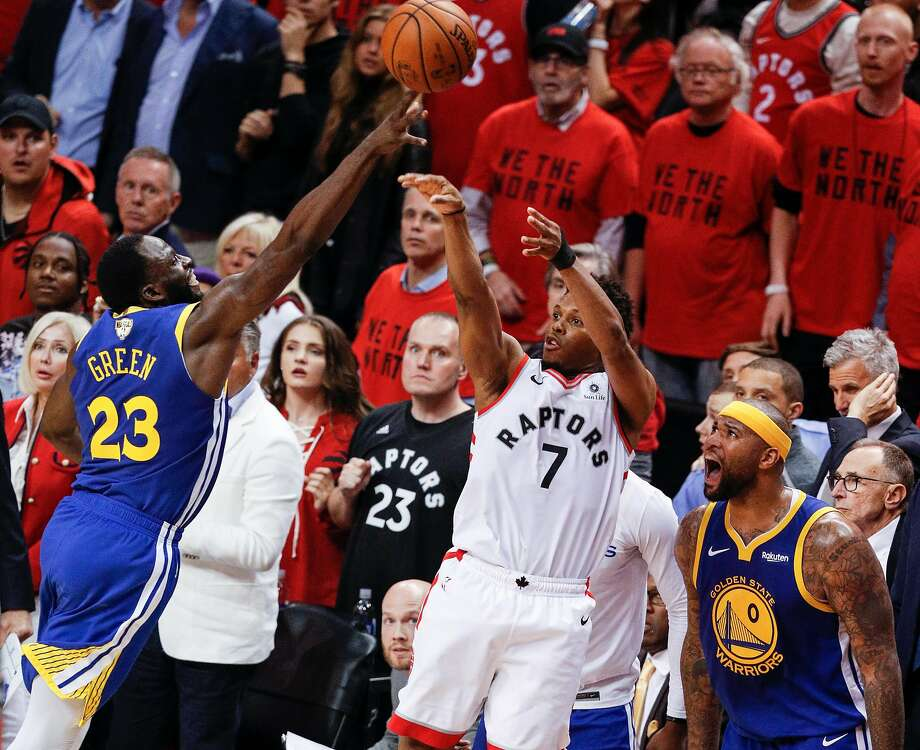 Golden State Warriors' Draymond Green gets his fingertips on Toronto Raptors' Kyle Lowry's last second three-point attempt in the fourth quarter during game 5 of the NBA Finals between the Golden State Warriors and the Toronto Raptors at Scotiabank Arena on Monday, June 10, 2019 in Toronto, Ontario, Canada. Photo: Carlos Avila Gonzalez, The Chronicle