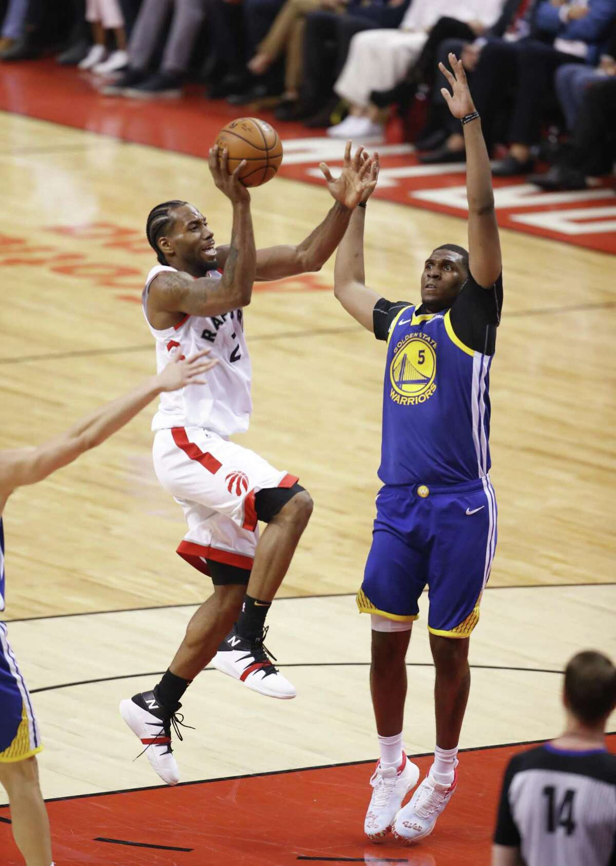 Toronto Raptors' Kawhi Leonard shoots over Golden State Warriors' Kevon Looney in the second quarter during game 5 of the NBA Finals between the Golden State Warriors and the Toronto Raptors at Scotiabank Arena on Monday, June 10, 2019 in Toronto, Ontario, Canada.