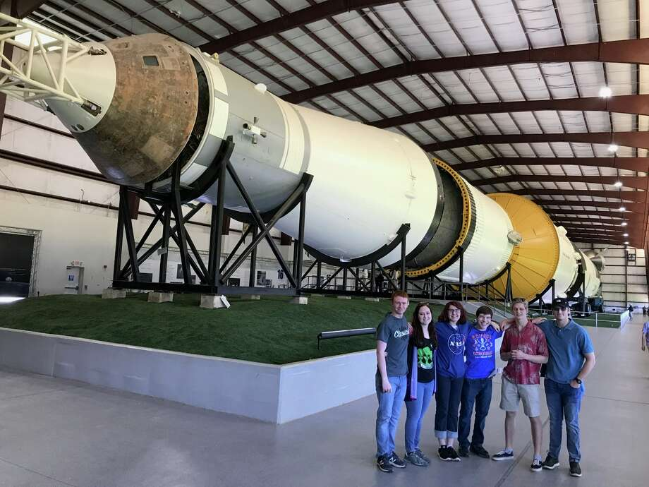 Midland Classical Academy senior astronomy students stand inside of the Lyndon B. Johnson Space Center while visiting NASA in Houston. Photo: Courtesy Of Corey Telschow