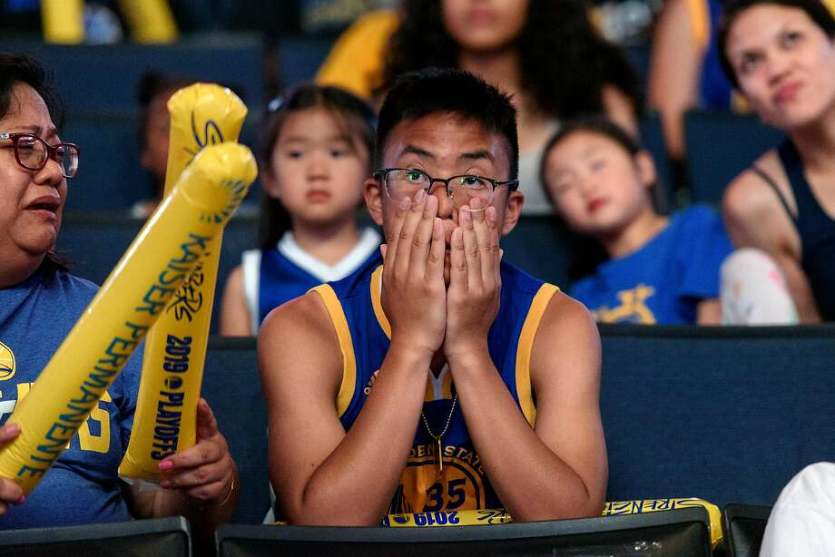 T.J. Caballero of Newark looks on in dismay as Kevin Durant reinsures his calf, during a watch party for Game 5 of basketball's NBA Finals between the Golden State Warriors and the Toronto Raptors at Oracle Arena in Oakland, Calif., on Monday, June 10, 2019. Photo: Michael Short, Special To The Chronicle