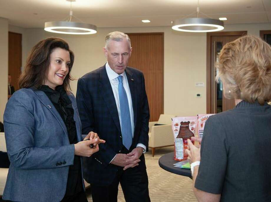 Michigan Gov. Gretchen Whitmer (left) walks with Dow CEO Jim Fitterling on Monday as she visits the Dow Center in Midland. (Photo provided) / Dow Chemical Company