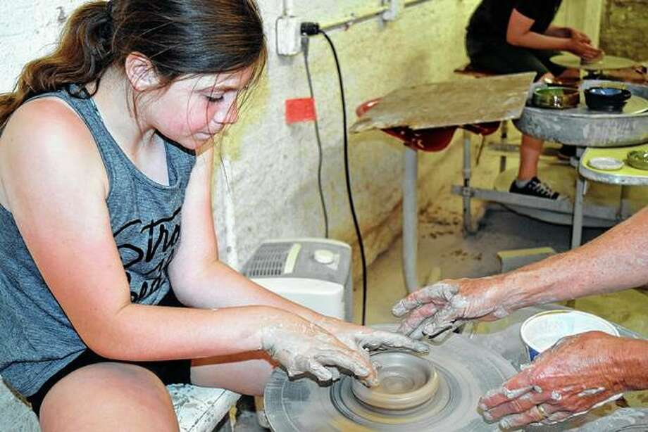 Emma Guidish, 10, the daughter of Allison and Nick Guidish of Jacksonville, works on a clay pot Monday during her first pottery class at the David Strawn Art Gallery. Photo: Samantha McDaniel-Ogletree | Journal-Courier