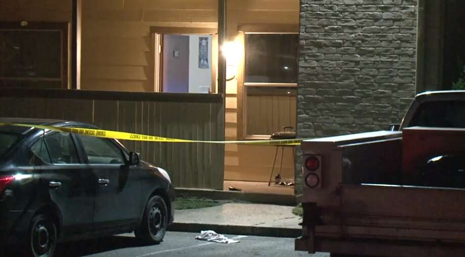 Harris County deputies respond to a home invasion incident Monday, June 10, at the Trails of Windfern Apartments in northwest Harris County. A woman was shot multiple times, but she is expected to survive, deputies said. Photo: Metro Video