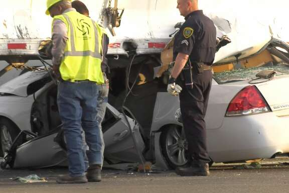 Houston police officers investigate after a woman allegedly fled from a traffic stop and crashed into an 18-wheeler on Orem at Almeda on Tuesday, June 11, 2019.