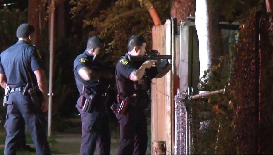 Police investigate a shooting Tuesday, June 11, during a home invasion near the Greater Heights area. A man was shot after three masked men broke into the home in the 2500 block of Darling, police said. Photo: Metro Video
