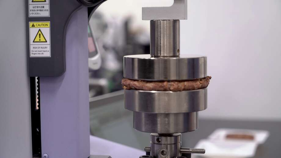 """The """"e-mouth"""" is an electronic chewing press that Beyond uses to quantify how new versions of burger push back when you chew. Photo: CNET"""