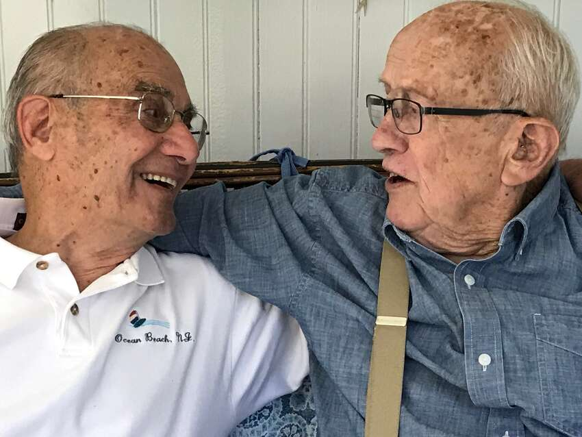 WWII vets Ignatius DeGenero, 94, left, of Troy, met Tom Hargrave, 95, more than 74 years after Hargrave's armored division liberated a POW camp at Moosburg, Bavaria where DeGenero was held with thousands of POWS the Germans captured.