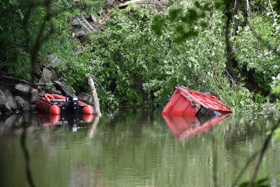A driver was killed and another was injured on the morning of Tuesday, June 11, 2019 in a crash that sent a dump truck into the Housatonic River in New Milford. Photo: Kendra Baker / Hearst Connecticut Media / The News-Times