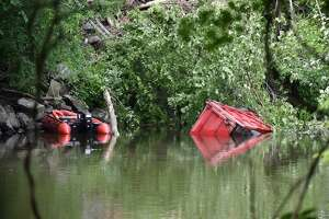 A driver was killed and another was injured on the morning of Tuesday, June 11, 2019 in a crash that sent a dump truck into the Housatonic River in New Milford.