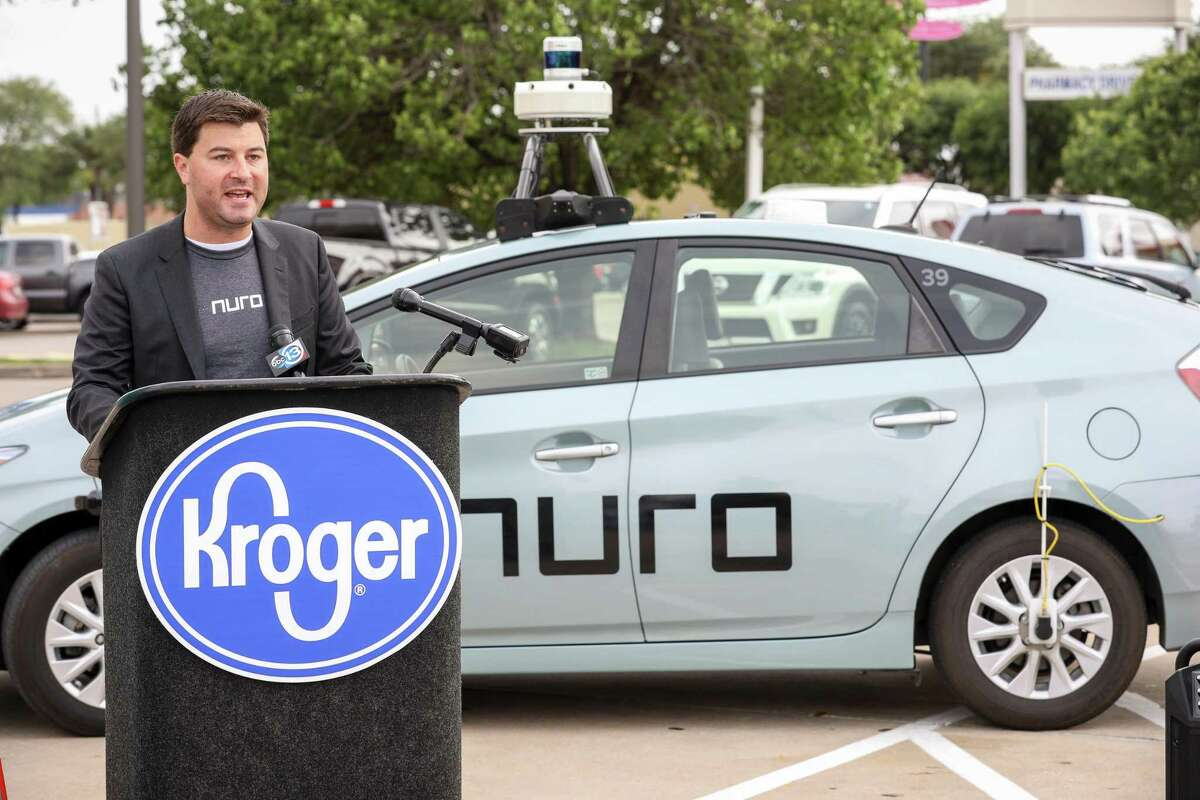 """Dan Mitchell, who works in product operations and community engagement at Nuro, speaks during a press conference to announce a """"driverless"""" delivery service, based on a partnership between Kroger and Nuro, at the Kroger store on South Post Oak Boulevard Tuesday, April 16, 2019, in Houston."""