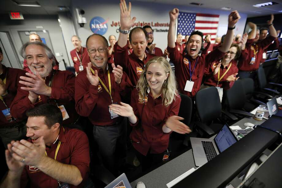 Engineers of the flight team react as the first image is beamed back after the successful landing of the NASA InSight spacecraft in the Mission Support Area of the Space Flight Operation Facility at JPL in Pasadena Monday, Nov. 26, 2018. (Al Seib/Los Angeles Times)