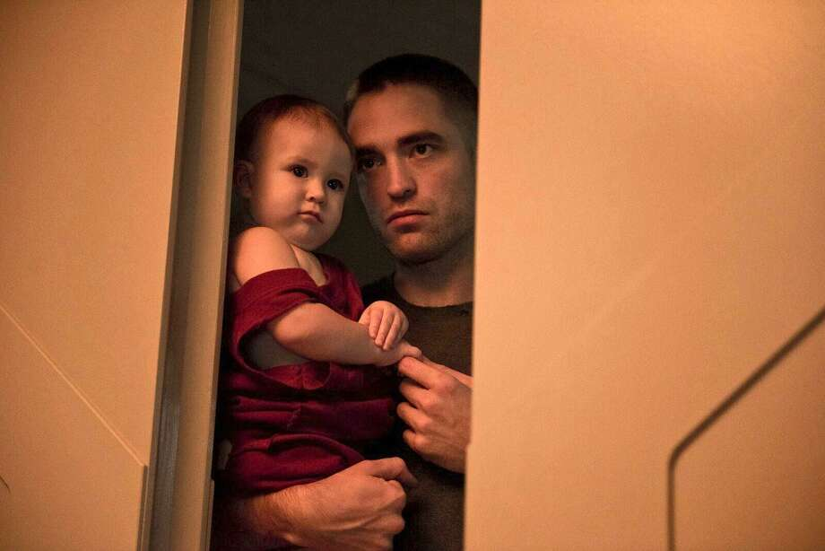 "Robert Pattinson and his baby daughter are a long way from home in ""High Life"" Photo: Associated Press / A24 Films"