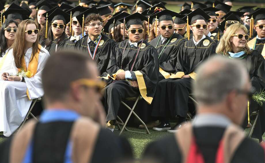 Milford, Connecticut - Friday, June 7, 2019: Graduating seniors listen to the Concert Choir during the Jonathan Law High School of Milford 2019 Graduation exercises Friday evening at the Law H.S. football field. Photo: Peter Hvizdak, Hearst Connecticut Media