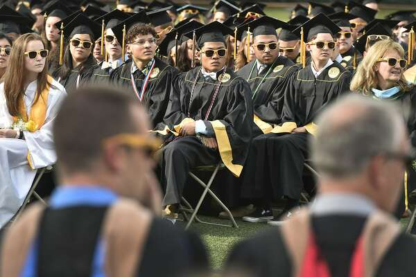 Milford, Connecticut - Friday, June 7, 2019: Graduating seniors listen to the Concert Choir during the Jonathan Law High School of Milford 2019 Graduation exercises Friday evening at the Law H.S. football field.