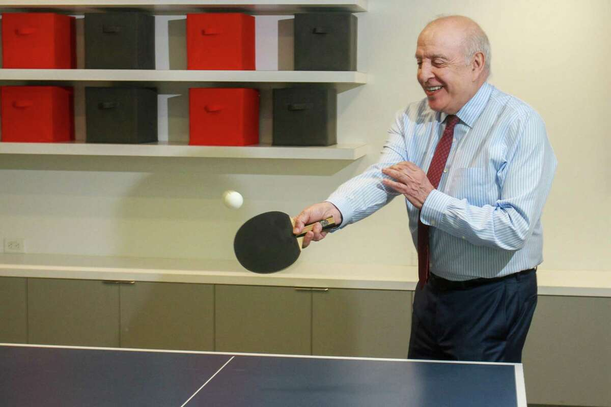 CEO Tony Grijalva of G&A Partners, playing a game of table tennis in the company break room. G&A Partners is an employee leasing company.