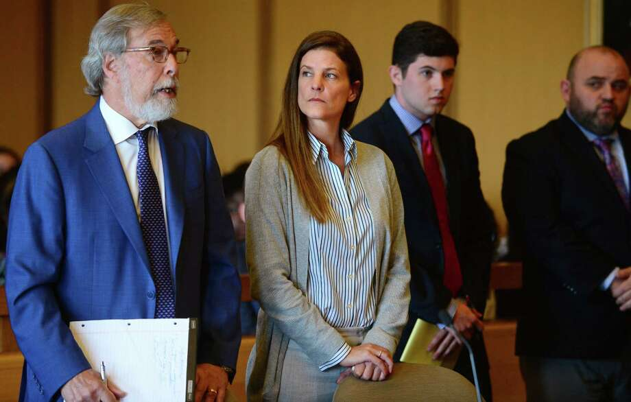 Michelle Troconis with her attorney Andrew Bowman, left, arrange their trial date in her appearance for tampering with evidence and hindering prosecution charges. Photo: Erik Trautmann / Hearst Connecticut Media / Norwalk Hour
