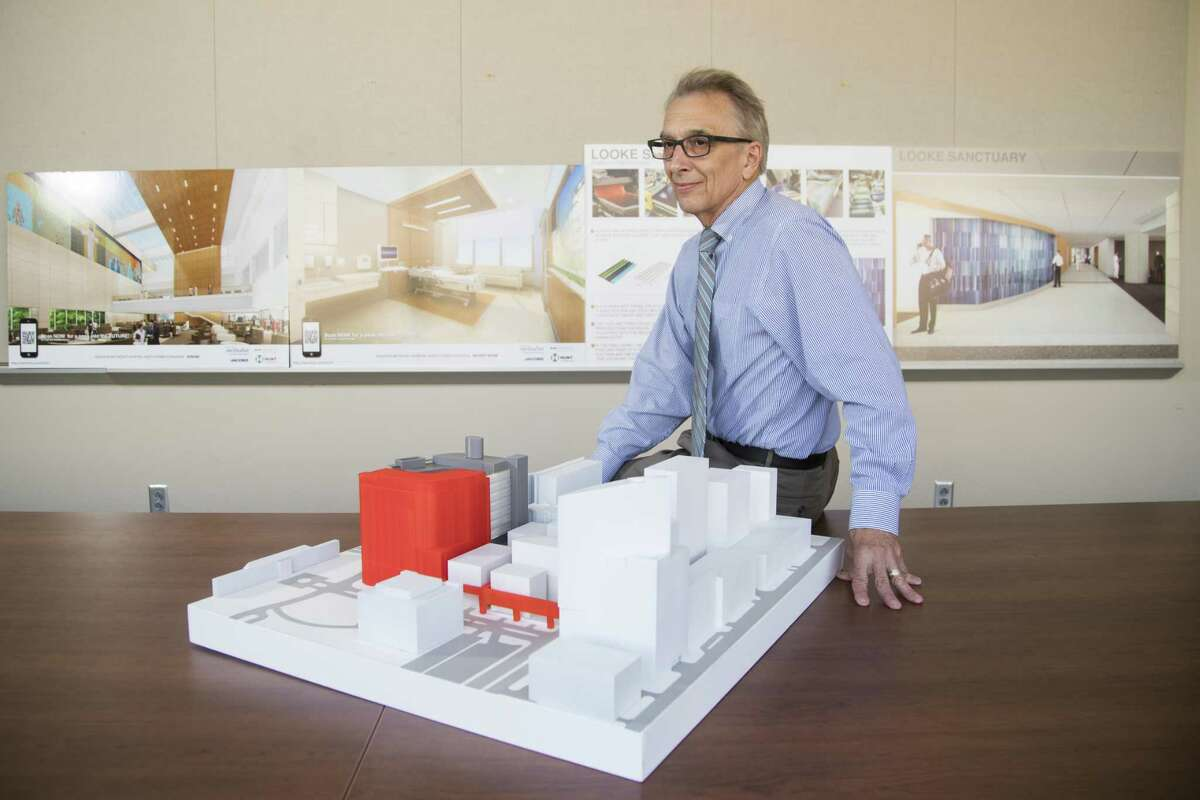 Sidney Sanders, Houston Methodist senior vice president of construction, facilities design and real estate by a model of the Houston Methodist campus on Monday, June 3, 2019, in Houston.