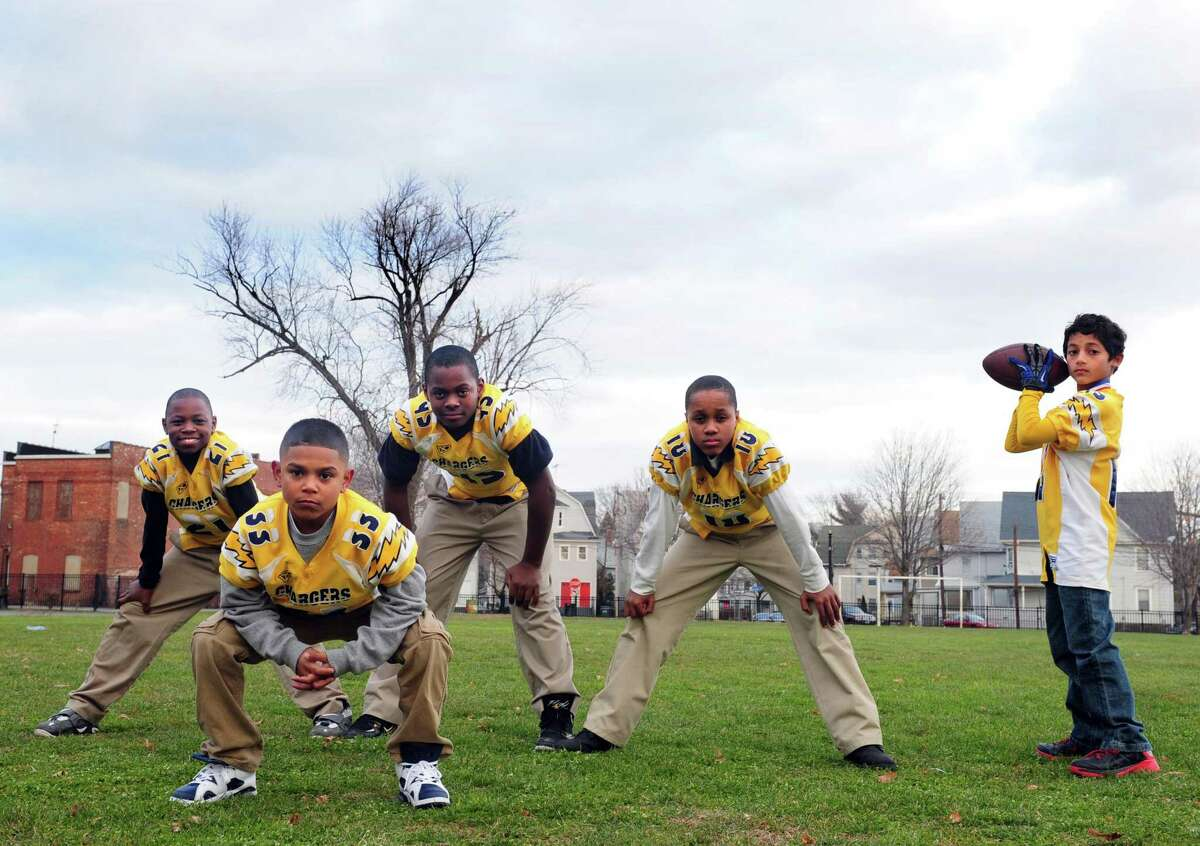 The Bridgeport Chargers United Youth Football team won the New England Regional Championship and are heading to the nationals in Florida. Members of the team, from left, Nazjhir Curry, Carlos Delvalle, Taevian Jackson, Mekhi Hamilton and Nico Provo stand in formation Wednesday, Nov. 28, 2012 at Went Field Park in Bridgeport, Conn.
