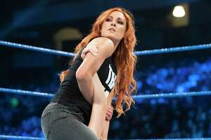 WWE superstar Becky Lynch, shown wrestling Peyton Royce, is expected to be in San Antonio in January for Monday Night RAW.