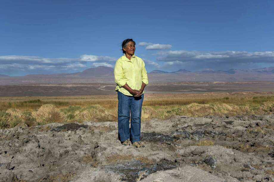 Sara Plaza stands on the dry meadow where her family's flock of sheep used to feed during winter months. Photo: Bloomberg Photo By Cristobal Olivares / Bloomberg