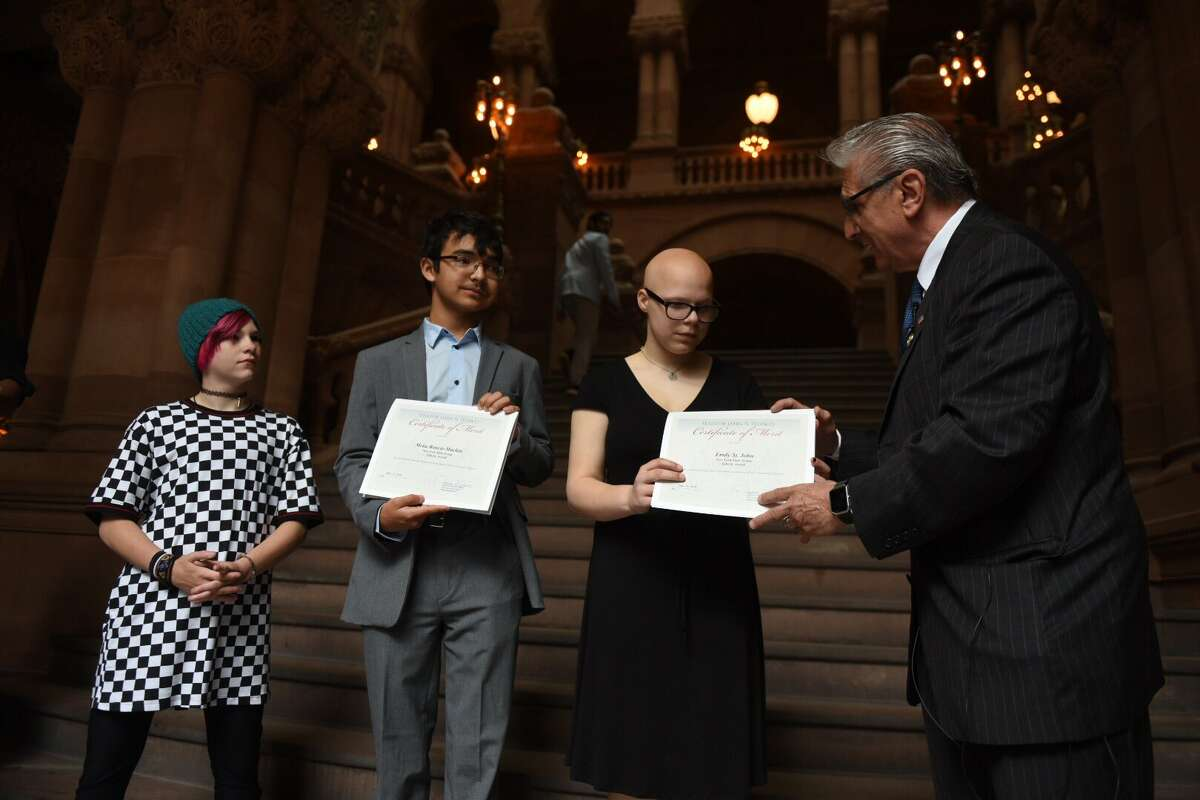 From left, Ava Horton, Meka Boncie-Machin and Emily St. John receive Liberty Medals Tuesday, June 11, 2019,from state Senator James Tedisco for rescue a man and woman who were struggling to stay afloat in Collins Lake in Scotia, N.Y.