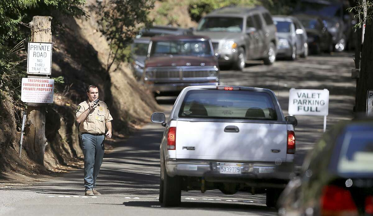 FILE - This July 17, 2015 file photo shows the entrance to the Bohemian Grove encampment in Monte Rio, Calif. A retreat for members of the elite Bohemian Club is facing renewed scrutiny for excluding women. This comes after the Sonoma County Board of Supervisors raised questions about whether sheriff's deputies should provide security for an event that discriminates by gender. Female supervisors say they were inspired by the #MeToo movement and in threats to women's rights nationally. (Kent Porter/Press Democrat via AP, File)