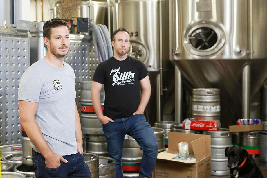 Founders Tim Obert (left) and Clint Potter pose at their brewery and distillery Seven Stills on Egbert Street. Photo: Liz Moughon / The Chronicle