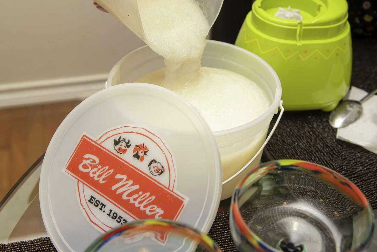 Cynthia Muñoz uses her Bill Miller iced tea buckets to make frozen margaritas using an off-the-shelf mix.